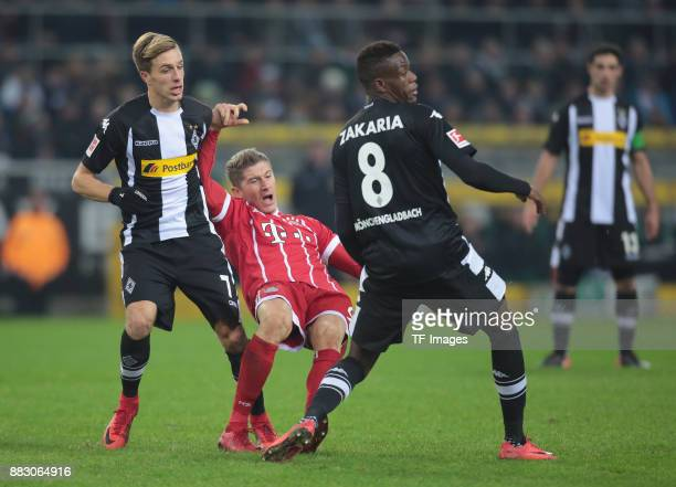Patrick Herrmann of Borussia Moenchengladbach Robert Lewandowski of Bayern Muenchen and Denis Zakaria of Borussia Moenchengladbach in action during...