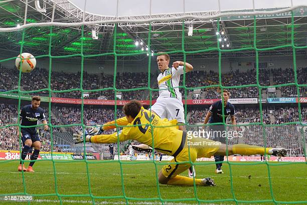Patrick Herrmann of Borussia Moenchengladbach shoots past goalkeeper Rune Almenning Jarstein of Hertha Berlin to score their third goal during the...