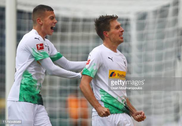 Patrick Herrmann of Borussia Monchengladbach celebrates with teammate Laszlo Benes after scoring his team's second goal during the Bundesliga match...