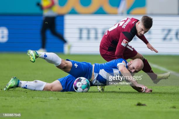 Patrick Herrmann of Darmstadt is challenged by Fabian Nuernberger of Nuernberg during the Second Bundesliga match between SV Darmstadt 98 and 1. FC...