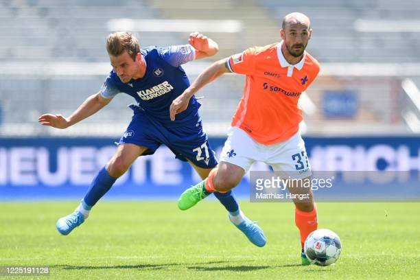 Patrick Herrmann of Darmstadt is challenged by Lukas Grozurek of Karlsruhe during the Second Bundesliga match between Karlsruher SC and SV Darmstadt...