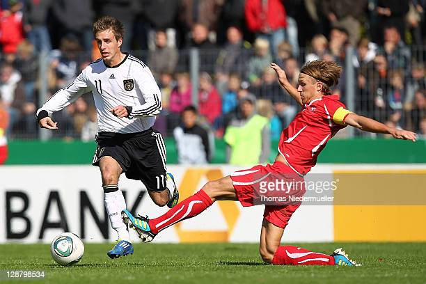 Patrick Herrmann of Germany fights for the ball with Michael Lang of Switzerland during the Under 20 International Friendly match between Germany and...