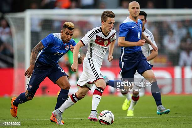 Patrick Herrmann of Germany is challenged by Danny Williams of the USA during the International Friendly match between Germany and USA at...