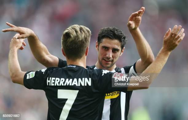 Patrick Herrmann of Moenchengladbach and Lars Stindl of Moenchengladbach celebrate after the Bundesliga match between Borussia Moenchengladbach and 1...