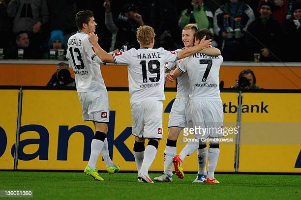 Patrick Herrmann of Moenchengladbach celebrates with teammates after scoring his team's opening goal during the Bundesliga match between Borussia...