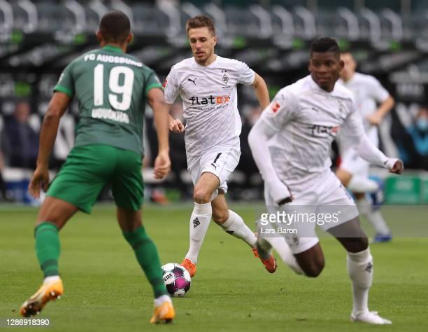 Patrick Herrmann of Moenchengladbach runs with the ball during the Bundesliga match between Borussia Moenchengladbach and FC Augsburg at BorussiaPark...