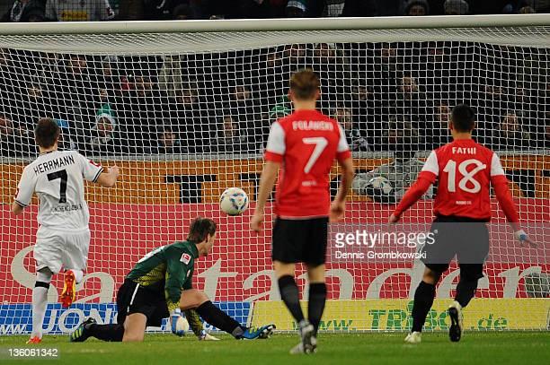 Patrick Herrmann of Moenchengladbach scores his team's opening goal during the Bundesliga match between Borussia Moenchengladbach and FSV Mainz 05 at...