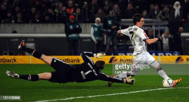 Patrick Herrmann of Moenchengladbach scores his teams third goal past goalkeeper Manuel Neuer of Muenchen during the Bundesliga match between...