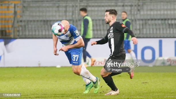 Patrick Herrmann of SV Darmstadt 98 and Besar Halimi of SV Sandhausen during the Second Bundesliga match between SV Darmstadt 98 and SV Sandhausen at...
