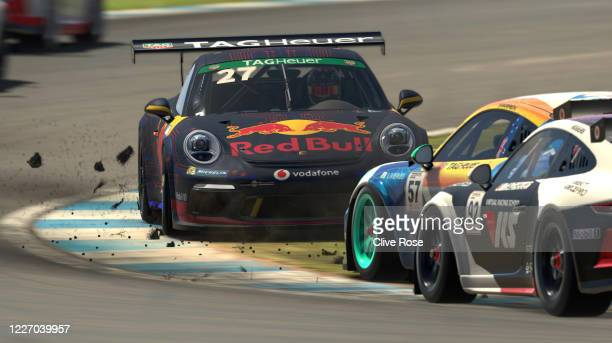 Patrick Holzmann of Germany driving the Red Bull Racing Esports Porsche 911 is hit from behind by Dwayne Warren of Logitech G Atlus Esports and spins...