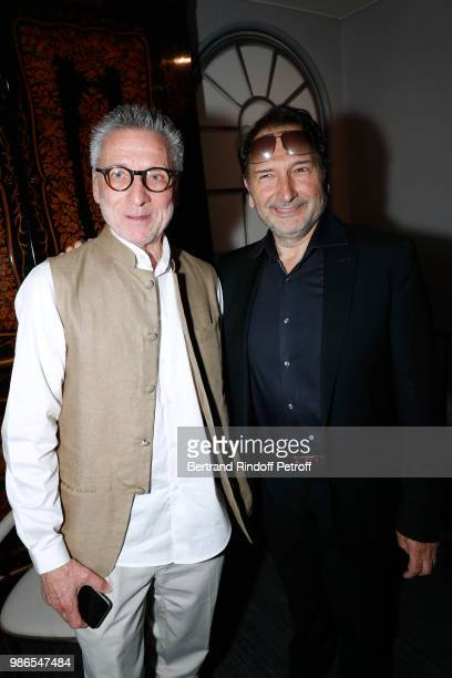 Patrick Hourcade and Peter Blunschi attend the Tan Giudicelli Exhibition of drawings and accessories preview at Galerie Pierre Passebon on June 28...