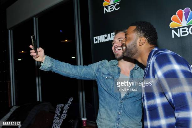 Patrick John Flueger and LaRoyce Hawkins attend the press junket for 'One Chicago' on October 30 2017 in Chicago Illinois