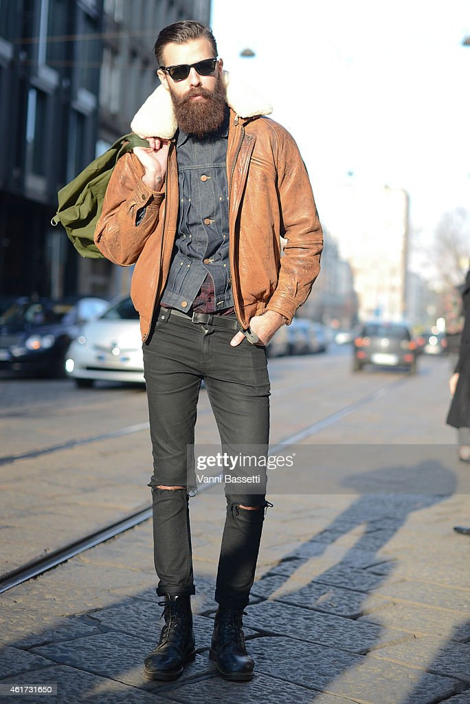 Patrick Jonasson poses wearing a vintage coat, Cheap Monday pants and Dr. Martens boots during day 2 of Milan Menswear Fashion Week Fall/Winter 2015/2016 on January 18, 2015 in Milan, Italy.