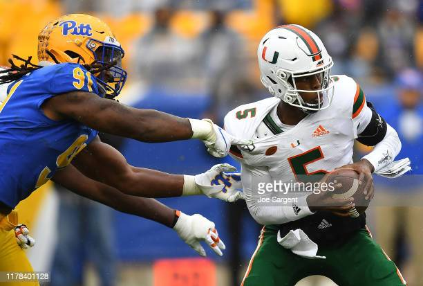 Patrick Jones II of the Pittsburgh Panthers sacks N'Kosi Perry of the Miami Hurricanes during the third quarter at Heinz Field on October 26, 2019 in...