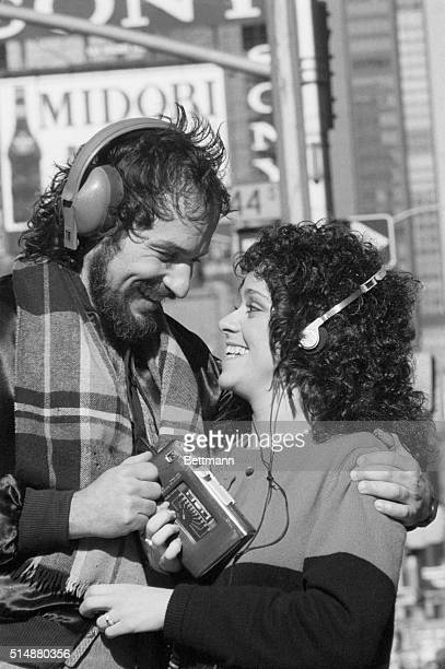 Patrick Jude and Lisa Mordente who were in the Broadway show Marlowe share a walkman in Times Square 1981