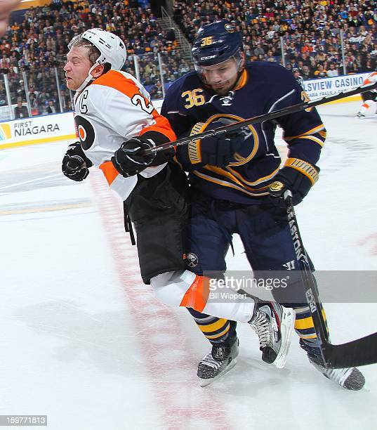 Patrick Kaleta of the Buffalo Sabres checks Claude Giroux of the Philadelphia Flyers on January 20 2013 at the First Niagara Center in Buffalo New...