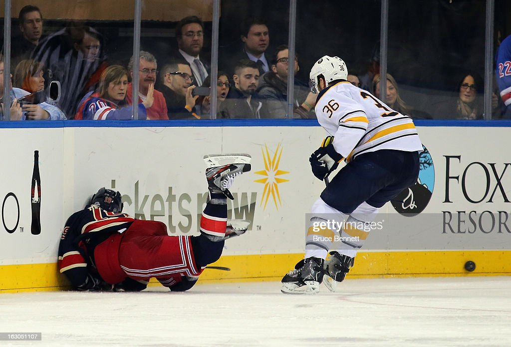 Patrick Kaleta #36 of the Buffalo Sabres gets a penalty for checking from behind and a game misconduct as he hits Brad Richards #19 of the New York Rangers into the boards at Madison Square Garden on March 3, 2013 in New York City. The Rangers defeated the Sabres 3-2 in the shootout.