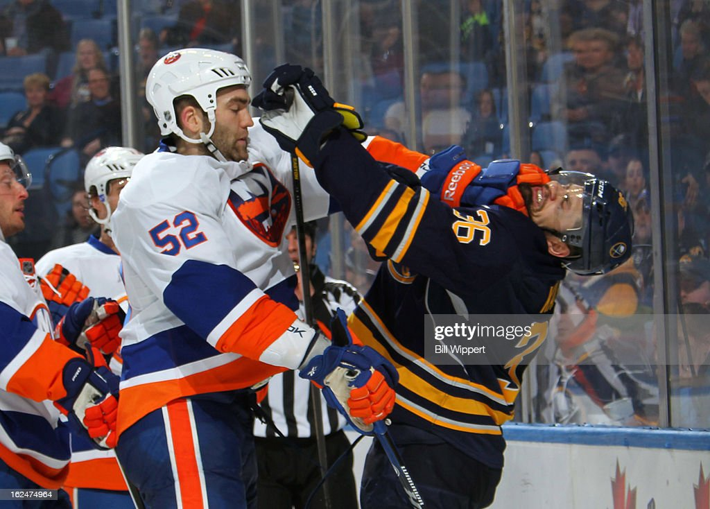 Patrick Kaleta #36 of the Buffalo Sabres is punched by Joe Finley #52 of the New York Islanders on February 23, 2013 at the First Niagara Center in Buffalo, New York.