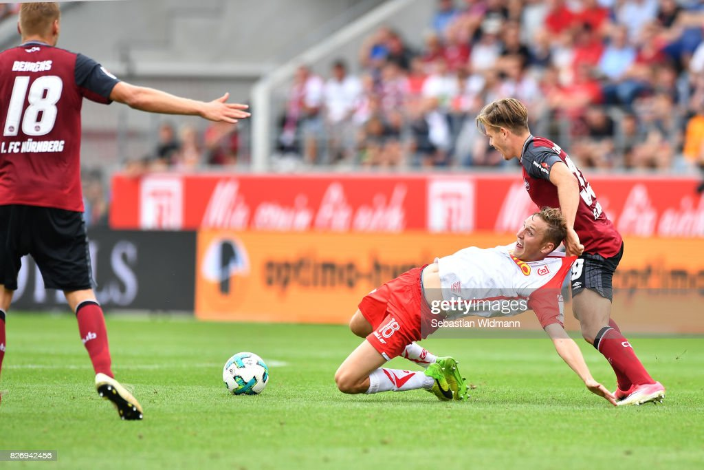 Patrick Kammerbauer of 1. FC Nuernberg fouls Marc Lais of SSV Jahn Regensburg during the Second Bundesliga match between SSV Jahn Regensburg and 1. FC Nuernberg at Continental Arena on August 6, 2017 in Regensburg, Germany.