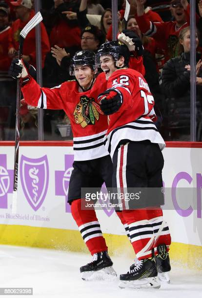 Patrick Kane and Alex DeBrincat of the Chicago Blackhawks celebrate DeBrincat's thrid goal of the game in the second period against the Anaheim Ducks...