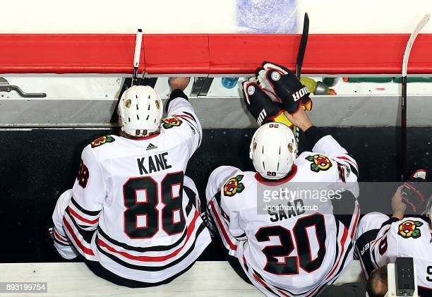 Patrick Kane and Brandon Saad of the Chicago Blackhawks look on from the bench during second period action against the Winnipeg Jets at the Bell MTS...