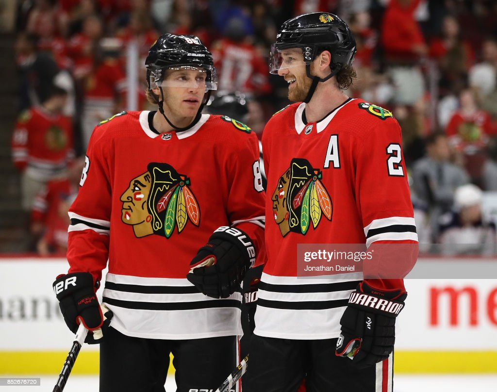 Patrick Kane #88 and Duncan Keith #2 of the Chicago Blackhawks chat before a face-off against the Columbus Blue Jackets during a preseason game at the United Center on September 23, 2017 in Chicago, Illinois. The Blue Jackets defeated the Blackhawks 3-2.