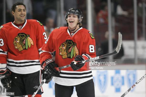 Patrick Kane and Dustin Byfuglien of the Chicago Blackhawks joke around during the shoot around before the game against the Boston Bruins at the...