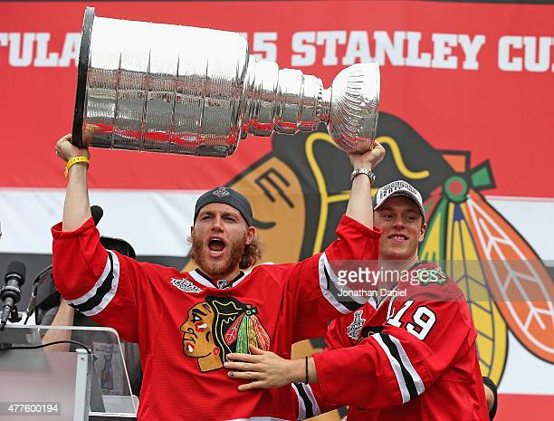 Patrick Kane and Jonathan Toews of the Chicago Blackhawks acknowlegde the crowd during the Chicago Blackhawks Stanley Cup Championship Rally at...