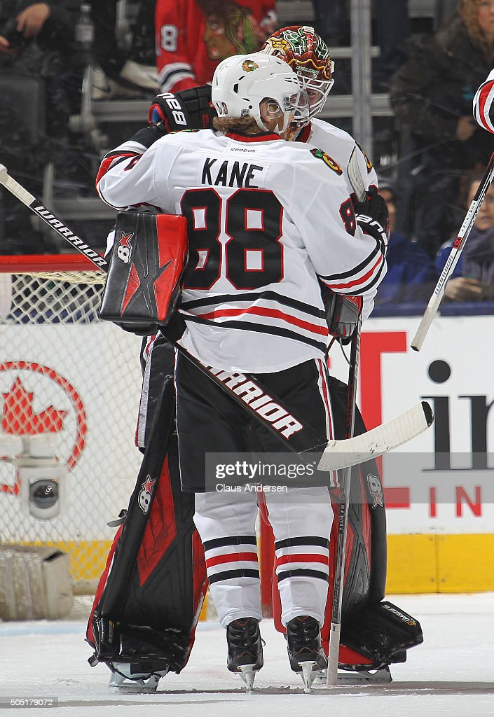 Patrick Kane #88 and Scott Darling #33 of the Chicago Black Hawks celebrate a victory against the Toronto Maple Leafs during an NHL game at the Air Canada Centre on January 15, 2016 in Toronto, Ontario, Canada. The Black Hawks defeated the Maple Leafs 4-1.