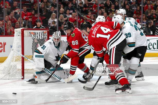 Patrick Kane and Victor Ejdsell of the Chicago Blackhawks watch the puck next to goalie Martin Jones of the San Jose Sharks in the second period at...