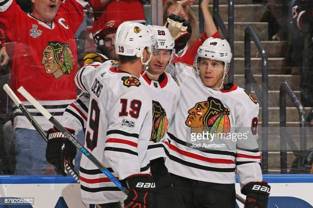 Patrick Kane celebrates his second period goal with Jonathan Toews and Brandon Saad of the Chicago Blackhawks against the Florida Panthers at the BBT...