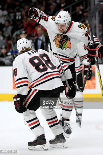 Patrick Kane congratulates Artemi Panarin of the Chicago Blackhawks after he scored a goal against the Los Angeles Kings during the third period of a...