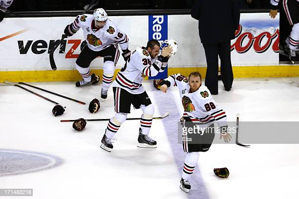 Patrick Kane Dave Bolland of the Chicago Blackhawks celebrates with Marcus Kruger after scoring the game winning goal late in the third period...