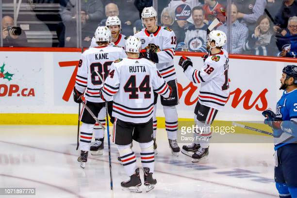 Patrick Kane Duncan Keith Jan Rutta Dylan Strome and Alex DeBrincat of the Chicago Blackhawks celebrate a second period goal against the Winnipeg...