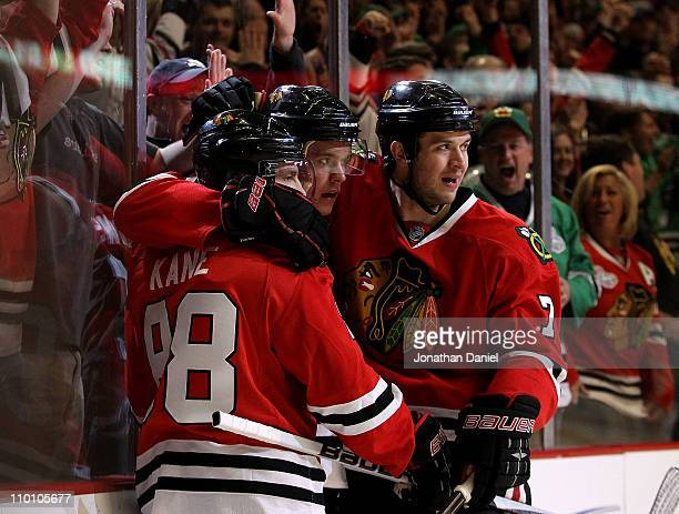 Patrick Kane Jonathan Toews and Brent Seabrook of the Chicago Blackhawks celebrate a goal by Toews against the San Jose Sharks at the United Center...