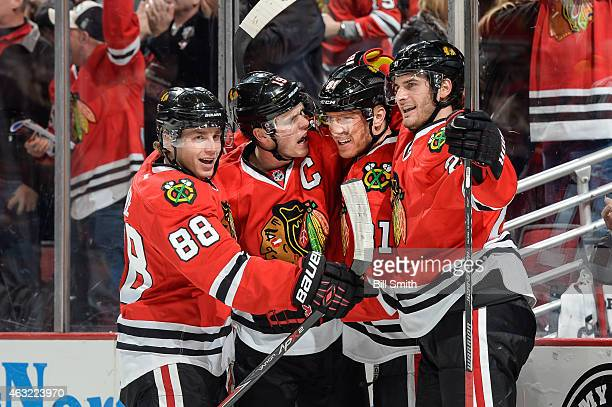 Patrick Kane Jonathan Toews Marian Hossa and Brandon Saad of the Chicago Blackhawks celebrate after Hossa scored against the Vancouver Canucks in the...