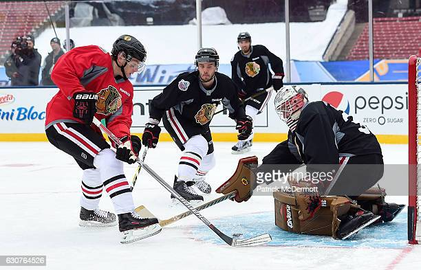 Patrick Kane Niklas Hjalmarsson Michal Rozsival and goaltender Scott Darling of the Chicago Blackhawks practice for the 2017 Bridgestone NHL Winter...
