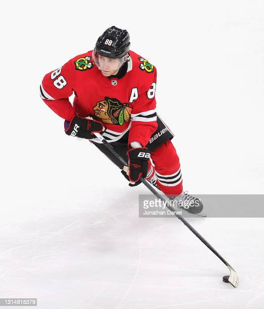 Patrick Kane of the Chicago Blackhawks advances the puck against the Nashville Predators at the United Center on April 23, 2021 in Chicago, Illinois....