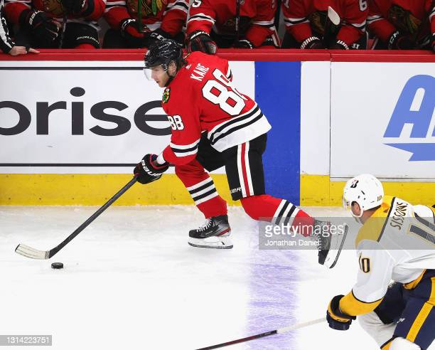 Patrick Kane of the Chicago Blackhawks advances the puck past Colton Sissons of the Nashville Predators at the United Center on April 23, 2021 in...