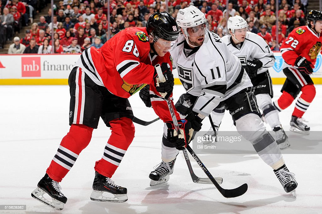 Patrick Kane #88 of the Chicago Blackhawks and Anze Kopitar #11 of the Los Angeles Kings face-off in the second period of the NHL game at the United Center on March 14, 2016 in Chicago, Illinois.