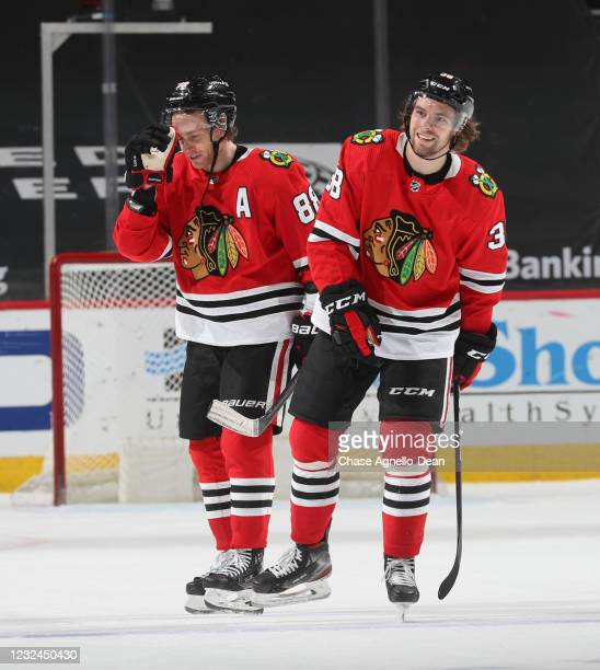 Patrick Kane of the Chicago Blackhawks and Brandon Hagel of the Chicago Blackhawks celebrate after their team's 5-4 win in overtime against the...