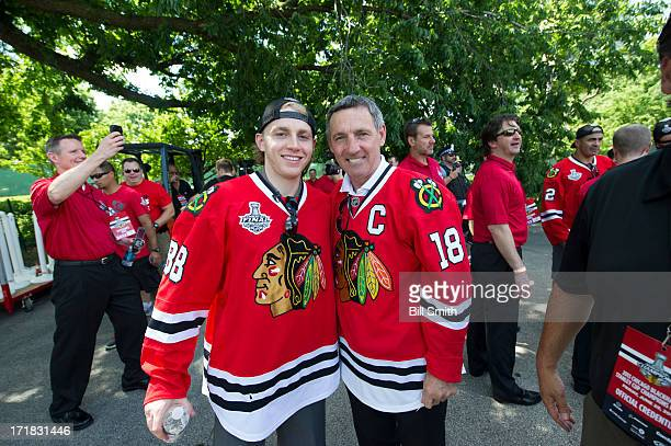 Patrick Kane of the Chicago Blackhawks and Hockey Hall of Famer Denis Savard pose for a photo during the Blackhawks Victory Parade and Rally on June...