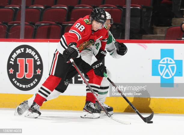 Patrick Kane of the Chicago Blackhawks and Tanner Kero of the Dallas Stars battle for the puck during the second period at United Center on May 10,...
