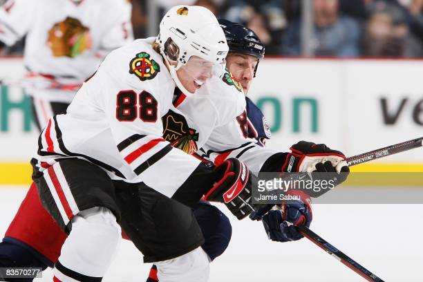 Patrick Kane of the Chicago Blackhawks battles R.J. Umberger of the Columbus Blue Jackets for control of the puck on November 1, 2008 at Nationwide...