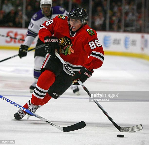 Patrick Kane of the Chicago Blackhawks brings the puck up the ice past Wayne Simmonds of the Los Angeles Kings at the United Center on November 9...