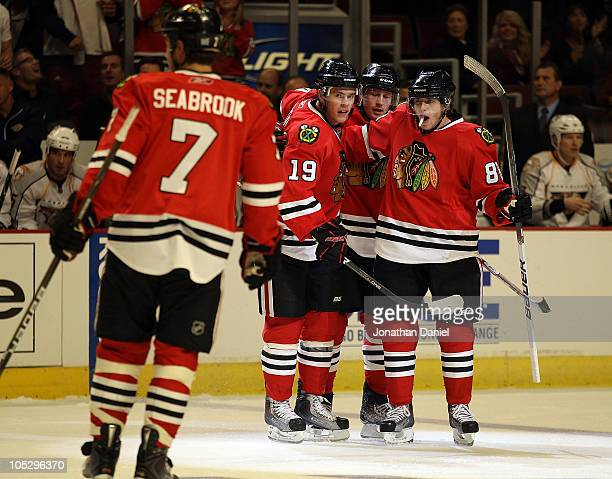 Patrick Kane of the Chicago Blackhawks celebrates a 1st period goal with teammates Brent Seabrook Jonathan Toews and Duncan Keith against the...