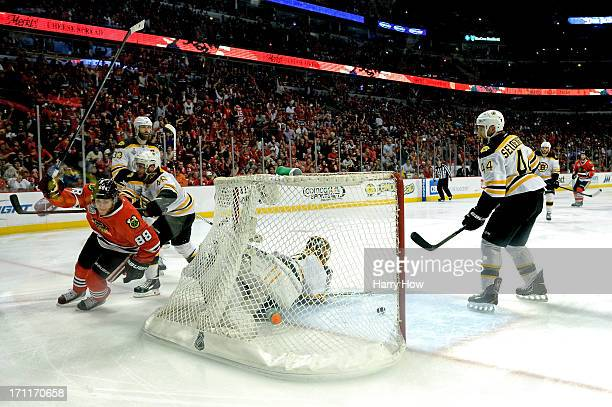 Patrick Kane of the Chicago Blackhawks celebrates after he scored a goal in the second period against goalie Tuukka Rask of the Boston Bruins in Game...