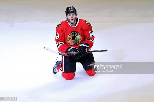 Patrick Kane of the Chicago Blackhawks celebrates after he scored the gamewinning goal in the second overtime period against the Los Angeles Kings...