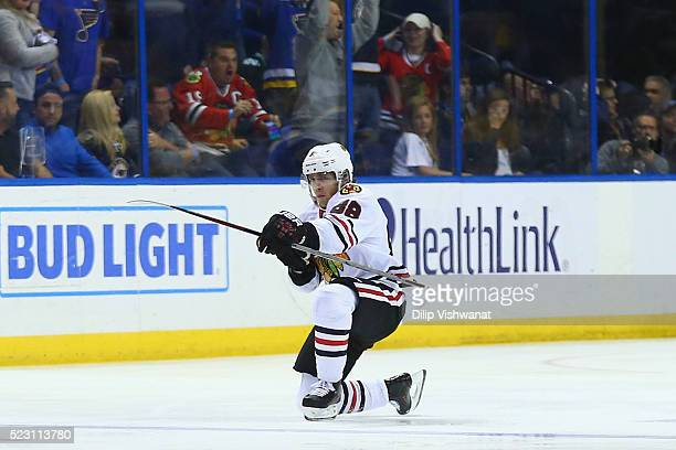 Patrick Kane of the Chicago Blackhawks celebrates after scoring the gamewinning goal against the St Louis Blues in Game Five of the Western...