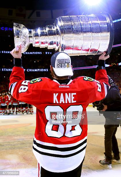 Patrick Kane of the Chicago Blackhawks celebrates by hoisting the Stanley Cup after defeating the Tampa Bay Lightning by a score of 20 in Game Six to...